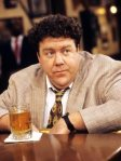 Norm Peterson (George Wendt)