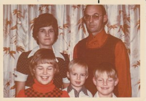 I do have a copy of the actual 1975 Petkau Family Photo where Mom and Dad look a little happier and where Barry and Karina's eyes are open, but where's the fun in that? (Besides, I look marginally cuter in this shot.)