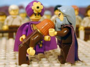Moses lays hands on Joshua in The Brick Testament album, Moses  Dies.