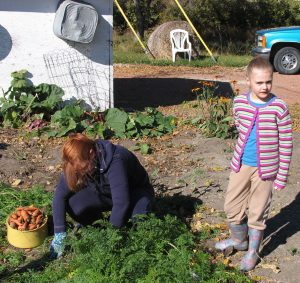 Karen and Katie Petkau help with the harvest in my mom's gareen on a Thanksgiving from yesteryear.