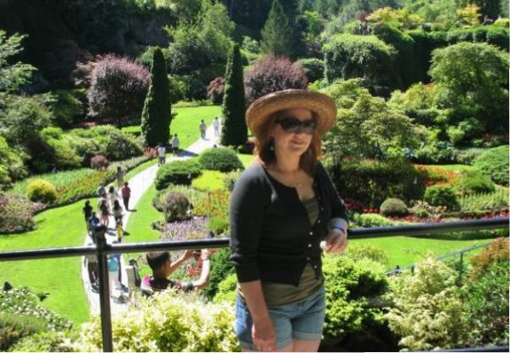 BREATH-TAKING BEAUTY! (The garden behind her ain't bad, either.) This is my wife, Karen, at Butchart Gardens in 2011. We took a trip to Victoria to celebrate our 15th wedding anniversary, and as we had done on our honeymoon, we visited The Butchart Gardens.